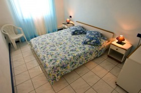 Ložnice v apartmánu