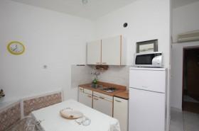 Posezení a kuchyňka