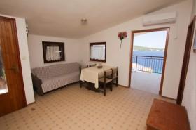 Obývací pokoj a vstup na balkon