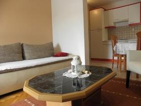 Obývací pokoj a kuchyňský kout