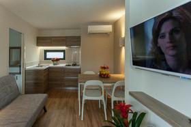Obývací část s kuchyňským koutem